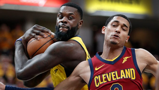 Indiana Pacers guard Lance Stephenson (1) rips a rebound away from Cleveland Cavaliers guard Jordan Clarkson (8) in the second half of game #3 of their NBA Eastern Conference playoff game on Friday April 20, 2018. The Indiana Pacers defeated the Cleveland Cavaliers 92-90.