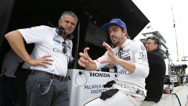 McLaren-Honda-Andretti driver Fernando Alonso spoke  with Gil de Ferran during Pole Day, May 21, 2017, at the Indianapolis Motor Speedway.
