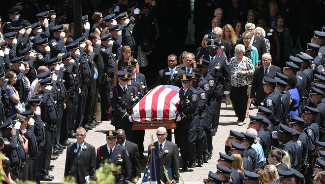 Funeral services for Indianapolis Metropolitan Police Department officer Perry Renn were held July 11 at Bankers Life Fieldhouse. Renn was fatally shot July 5 during a gunbattle in an Eastside alley.