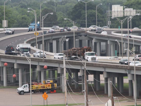 Traffic moves along the elevated portion of Interstate