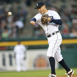 Tigers second baseman Ian Kinsler throws out Twins centerfielder Danny Santana during the fifth inning of the Tigers' 7-2 win over the Twins Tuesday at Comerica Park.