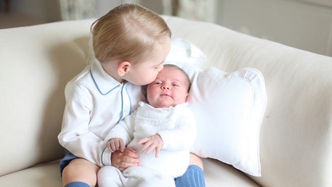 Prince George with sister Princess Charlotte at Anmer Hall in May 2015.