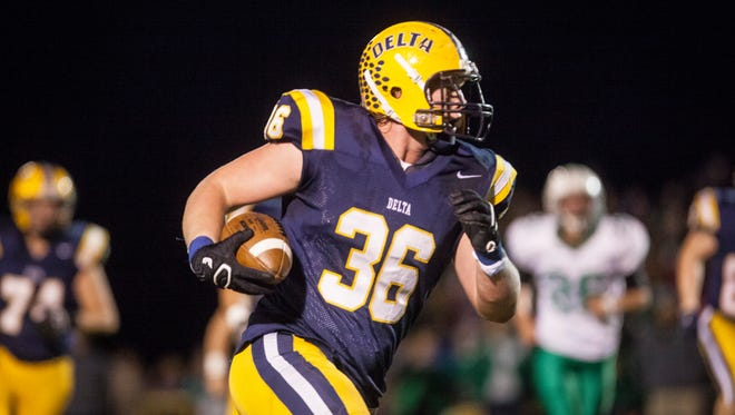 Kaleb Slaven runs the ball on Friday night during the sectional against New Castle at Delta. Delta won 49-7.