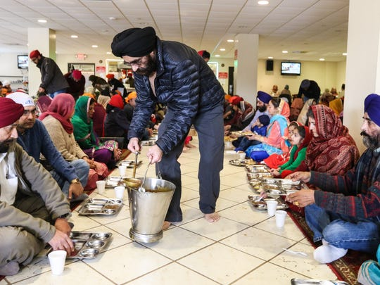 Jasvinder Singh gives out food at Langar, a Sikh religion