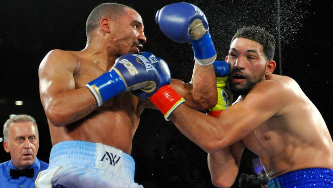 Andre Ward lands a left uppercut against Edwin Rodriguez at Citizens Business Bank Arena Saturday. Ward won a unanimous decision.