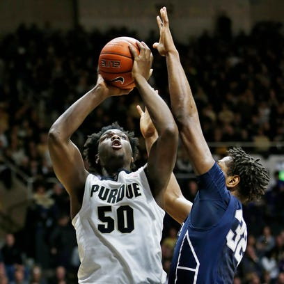 Caleb Swanigan with a shot over Jordan Dickerson of