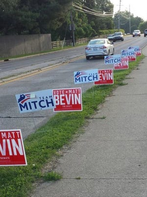 Interesting signs placement on election day along Dutchman's Lane.