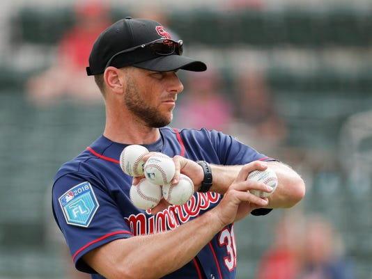 FILE - This Feb. 23, 2018 file photo shows Minnesota Twins major league coach Jeff Pickler participating in batting practice before a spring training baseball game against the Boston Red Sox in Fort Myers, Fla. The Twins have one of baseball's most talented outfields, and the coach they've assigned to tutor the young trio, Jeff Pickler, is also one of the game's up-and-coming coaches. (AP Photo/John Minchillo, file)