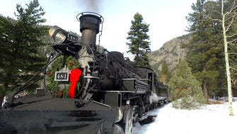The Christmas Tree Train on the Durango & Silverton Narrow Gauge Railroad in Colorado offers passengers a chance to harvest their own tree and haul it back by train.
