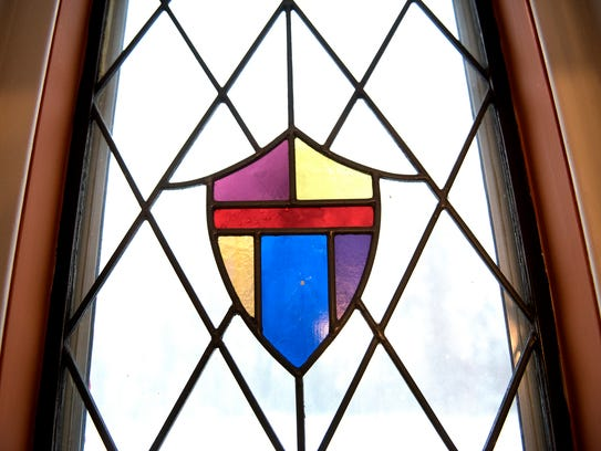 Stained glass window details adorn windows on the man