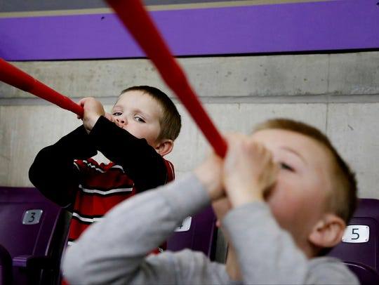 Four-year-old Hunter Livermore, of Elmira, raises a