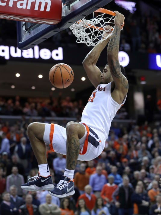 Virginia forward Isaiah Wilkins (21) dunks the ball during an NCAA college basketball game against Louisville, Wednesday, Jan. 31, 2018, in Charlottesville, Va. (AP Photo/Andrew Shurtleff)