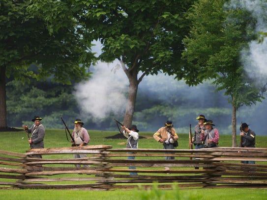Civil War re-enactors re-enact a battle at the Tinker