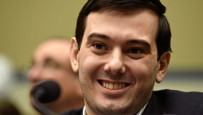 In this Feb. 4, 2016 file photo, Pharmaceutical chief Martin Shkreli smiles on Capitol Hill in Washington during the House Committee on Oversight and Reform Committee hearing on his former company's decision to raise the price of a lifesaving medicine.