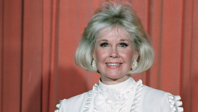 Actress and animal rights activist Doris Day holds  the Cecil B. DeMille Award she was presented with at the annual Golden Globe Awards in Los Angeles in 1989.