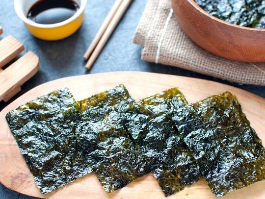 Seaweed wafer snacks on a wooden board