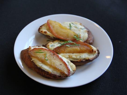Roquefort crostini arrive with slivers of caramelized