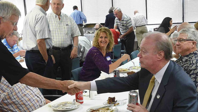 Louisiana Secretary of State Tom Schedler is introduced to Jim Lopez of the Opelousas Rotary Club where he served as guest speaker at the group's weekly luncheon held Tuesday at Opelousas General Health System South Campus.