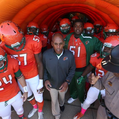 FAMU Head Coach Alex Wood leads his team out on to