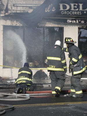 Mount Vernon firefighters fight a stubborn storefront fire on Gramatan Avenue in October.