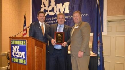 Yonkers Mayor Mike Spano, center, accepts the New York State Conference of Mayors Local Government Achievement Award.
