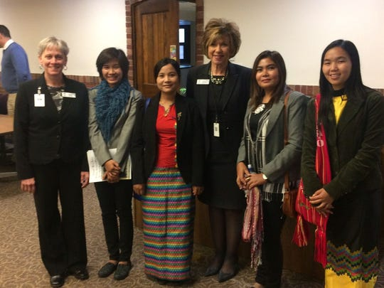 A delegation of visiting professionals from Myanmar attended the Green Bay School District budget hearing at the district office Tuesday night, Pictured with the four women are Green Bay School Board President Brenda Warren, left, and Green Bay Superintendent Michelle Langenfeld, third from right.