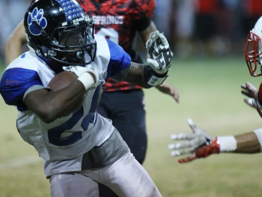Cathedral City High School's James Green III runs for yardage against Palm Springs High School during their game at Palm Springs.