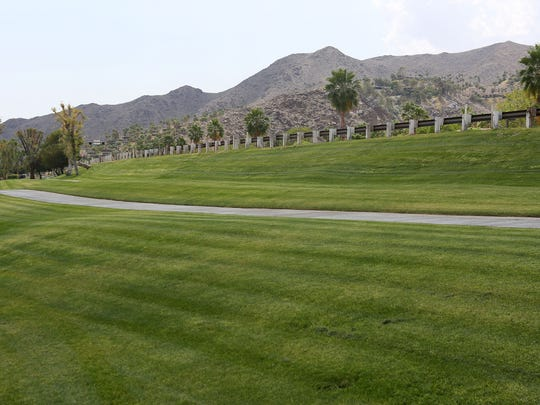 A large expanse of grass is seen Tuesday at the San Jacinto Village Apartment Complex in Palm Springs. Some residents in the desert are gradually replacing their green lawns with water-conservative plants.