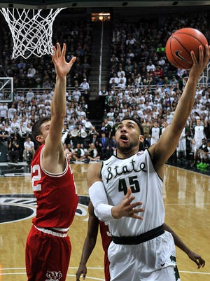 Denzel Valentine drives into the paint for a basket off the glass during MSU's win over Wisconsin last week.