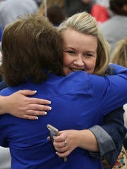 Kayla McClure, right, embraced Onna Owens after McClure gave a testimonial about becoming clean and sober during the Rockcastle County Operation UNITE coalition community celebration.  Owens was the assistant principal at Rockcastle County Middle School when Kayla was a student there.  The event was held at the Rockcastle County Middle School.Apr. 25, 2018