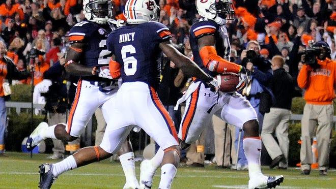 Auburn cornerback Chris Davis scores the game-winning touchdown, returning Alabama kicker Adam Griffith's missed kick for a touchdown during last year's Iron Bowl.