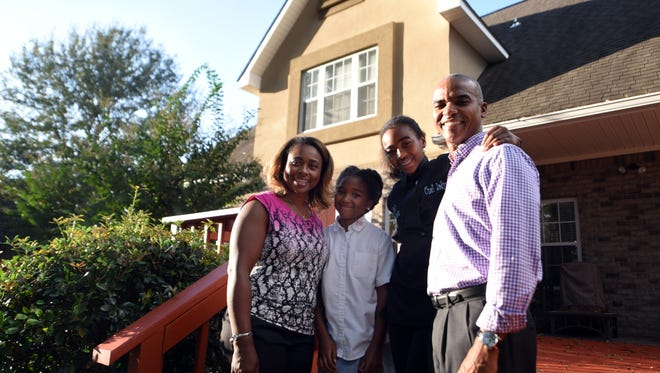 Lakeisha, from left, Kailyn, Jadyn and Dr. Steven Cunningham pose for a photo outside their home in Hattiesburg.