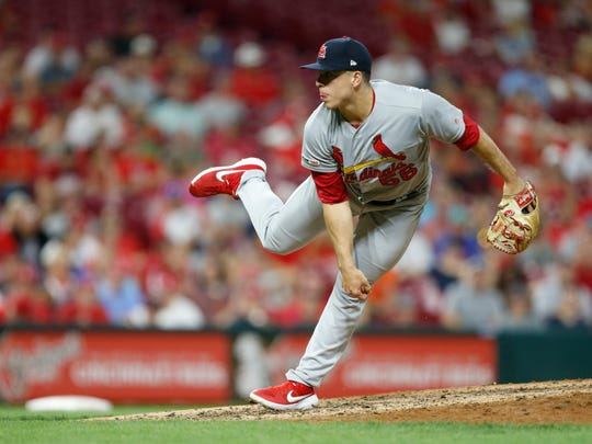 Former Springfield Cardinals pitcher Ryan Helsley throws against the Cincinnati Reds during the eighth inning of a baseball game in Cincinnati.