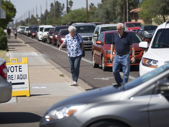 Traffic backs up on East University Drive as voters