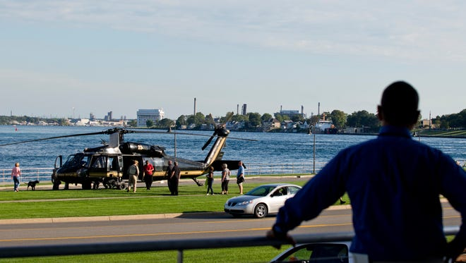People looks off a balcony at the Customs and Border Protection helicopter during the 100 Men charity event Thursday, September 10, 2015 at the Blue Water Convention Center in Port Huron.