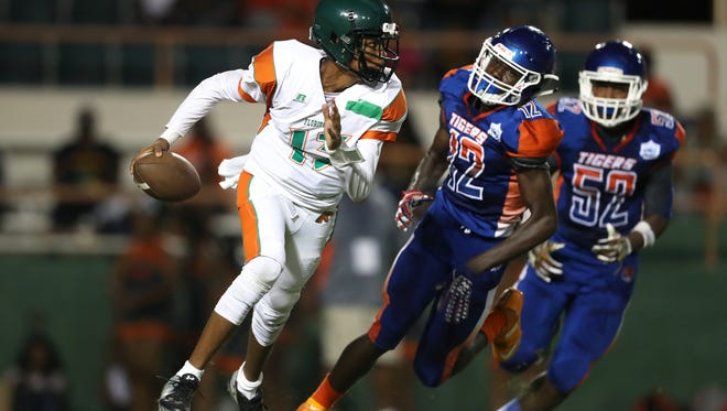 FAMU DRS' DJ Johnson scrambles out of the pocket against Jefferson County during their Friday night game at Bragg Memorial Stadium.