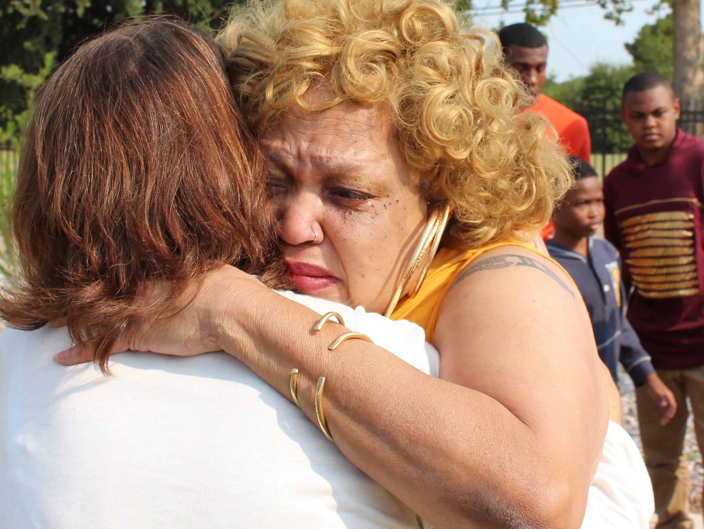 Annette James Hudson hugs Julie Sandefer after Wednesday's