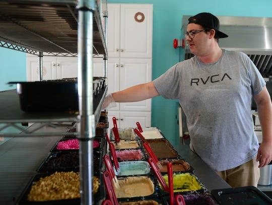 Robert Schaffer prepares custom fresh donuts at the