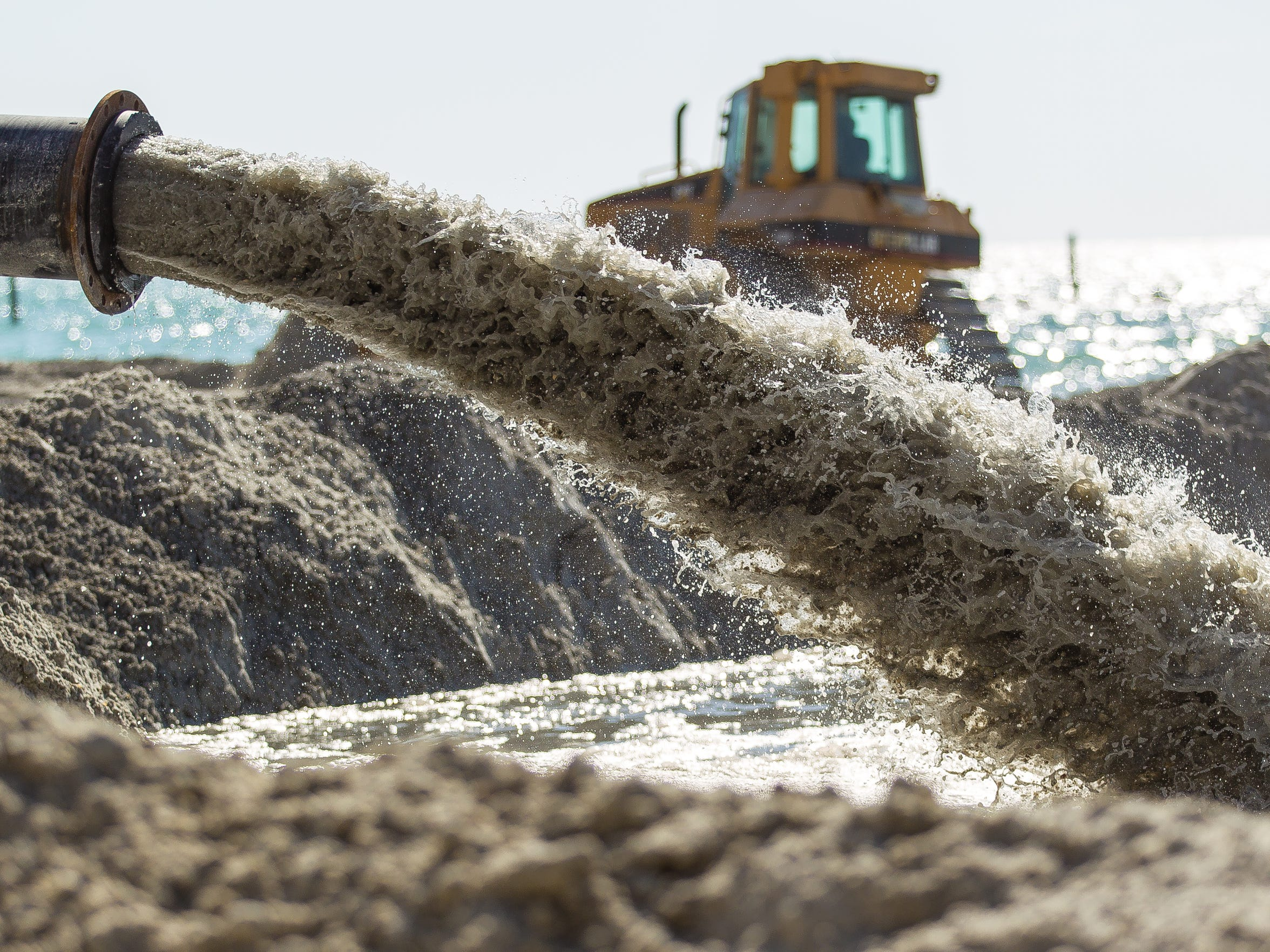 In this April 2013 file photo, sand is pumped onto