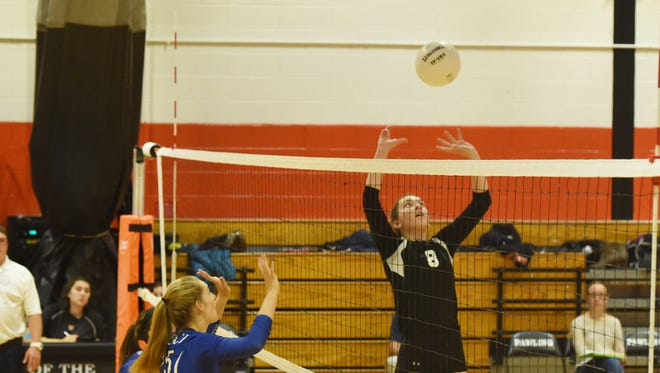 Pawling's Clara Lombardo, right, hits the ball up for a spike during sectional win against Haldane on Nov. 2