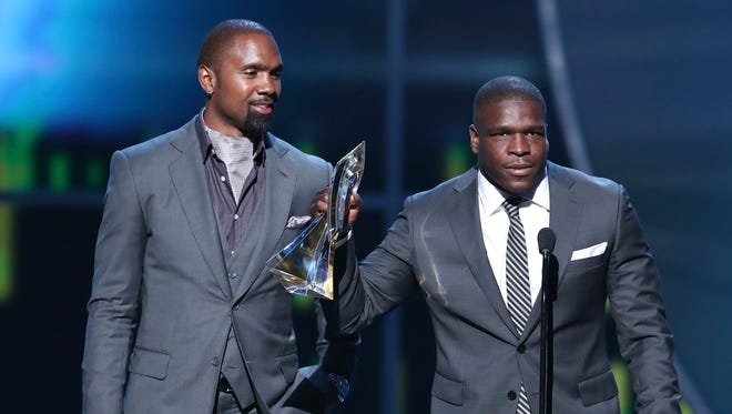 IMAGE DISTRIBUTED FOR NFL - Former NFL player Charles Woodson, left, presents Frank Gore of the Indianapolis Colts with the Art Rooney Sportsmanship Award at the 6th annual NFL Honors at the Wortham Center on Saturday, Feb. 4, 2017, in Houston.