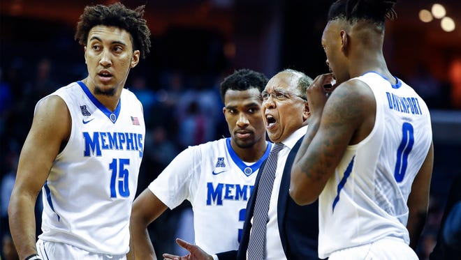 Memphis head coach Tubby Smith (second right) during a break in action against Northern Kentucky at the FedExForum in Memphis Tenn., Saturday, November 25, 2017.