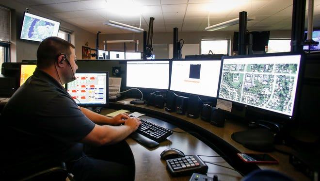 Eaton County 911 dispatch supervisor Francis D'Huyvetter works Wednesday, Oct. 11, 2017, at the dispatch center in Charlotte. Voters will decide Nov. 7 whether a monthly surcharge fee can be assessed on every phone line in the county to pay for a $12.8 million upgrade to Eaton County's 911 radio system.