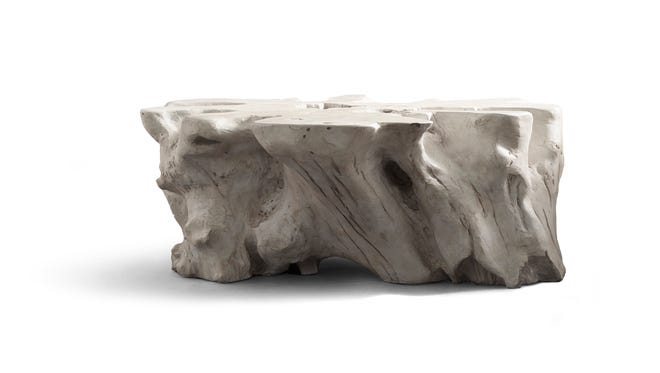 A Malay table. It is a teak root cast in lightweight all-weather cement; it's textural, wind-scoured look makes it a striking piece for a modern pool or patio deck.