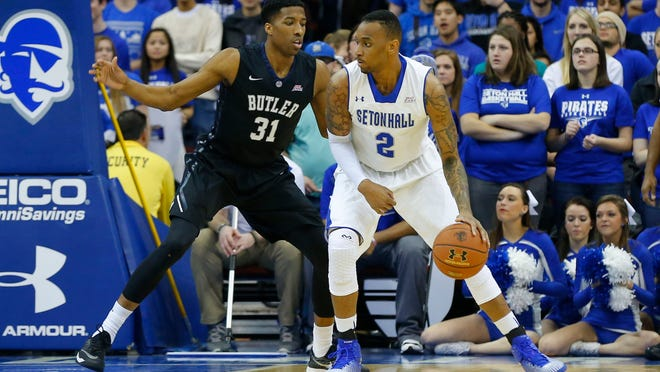 Seton Hall Pirates forward Brandon Mobley (2) works against Butler Bulldogs forward Kameron Woods (31) at the Prudential Center on Tuesday night.