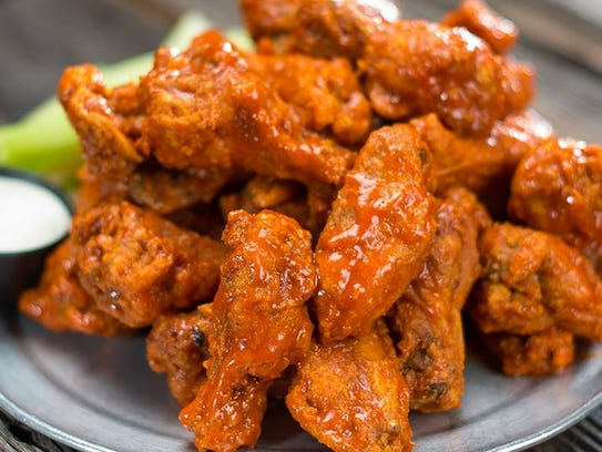 Cheer on your team while eating delicious hot wings at Native Grill and Wings.