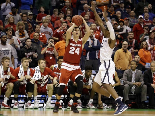 Bronson Koenig – along with the Wisconsin bench and fans – eyes the winning shot against Xavier. Koenig capped a 15-4 Badgers run with a three-pointer at the buzzer.
