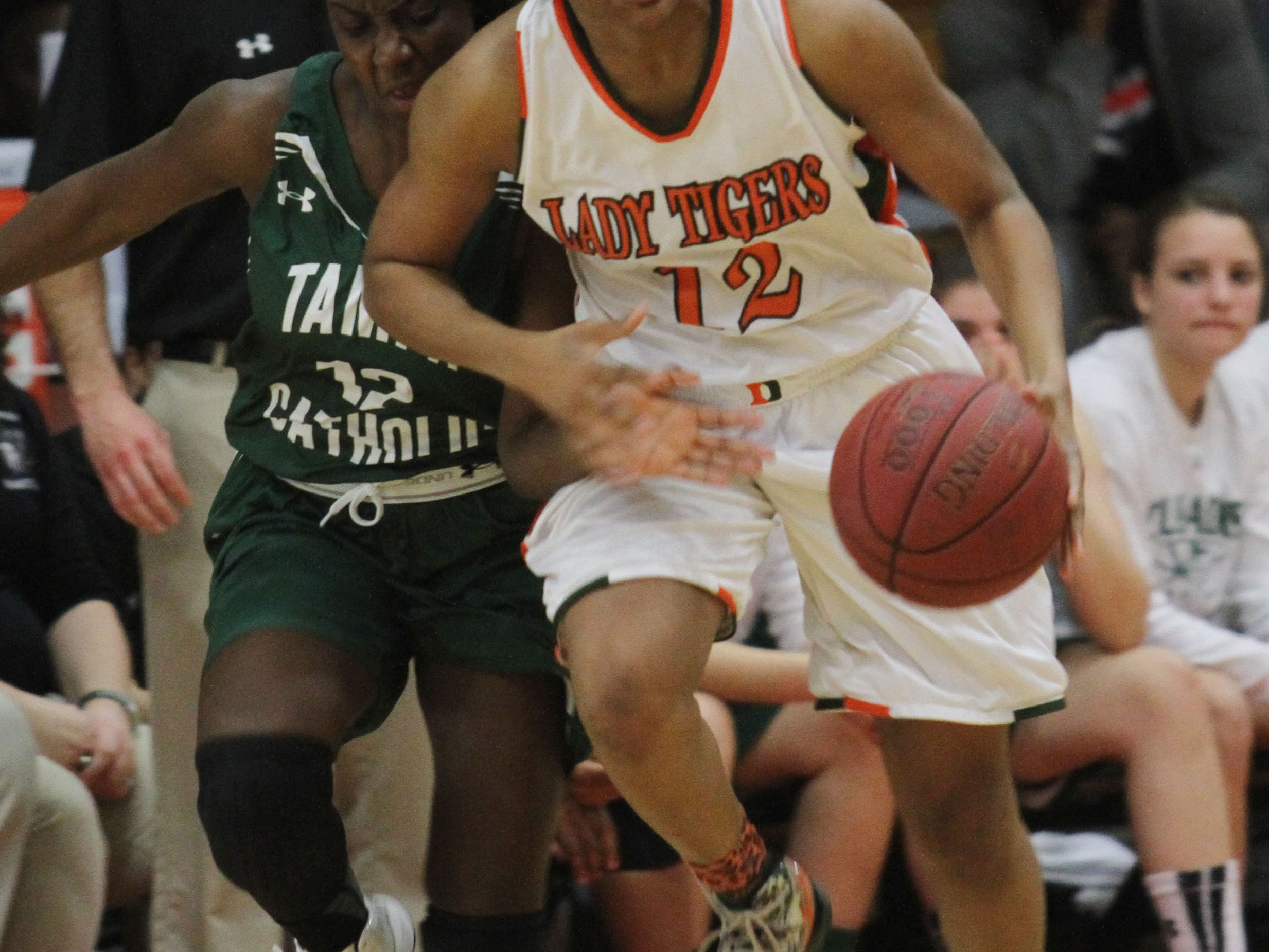 Dunbar's Kiara Desamours steals the ball from Tampa Catholic's Mia Blocker during the Region 4A-3 girls basketball championship game at Dunbar High School on Friday night.