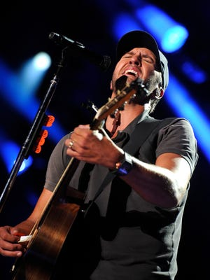 Luke Bryan performs onstage during the CMA Music Festival at LP Field, Friday, June 12, 2015, in Nashville, Tenn.