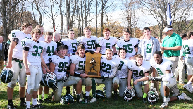 Christ School football players celebrate after beating Asheville School in 2013.